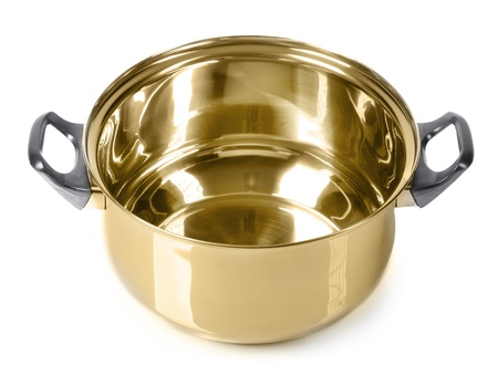 Empty golden pan on isolated on white background photo