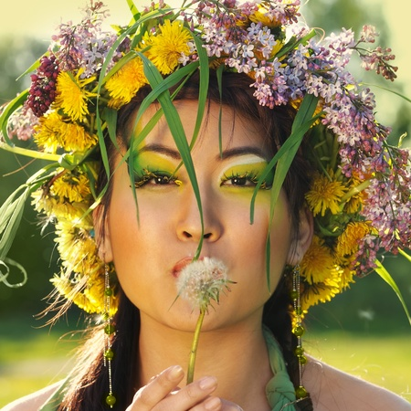 Asian woman in nature with flower wreath on head