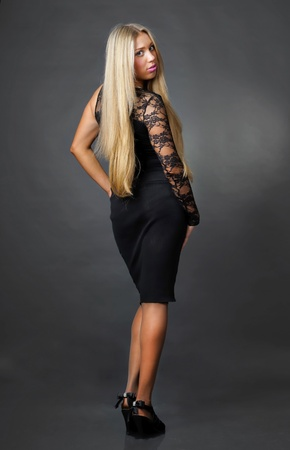 Blonde lady in black dress photo