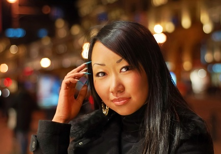 Asian woman at night outdoor Stock Photo - 12659752