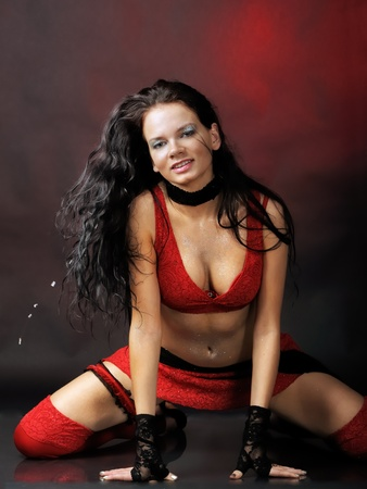 Woman in red dance costume photo