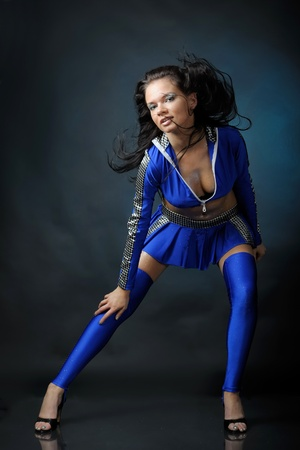 Woman in blue costume is dancing photo
