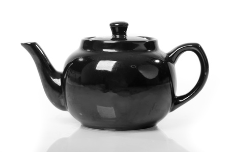 Ceramic teapot isolated on white background photo