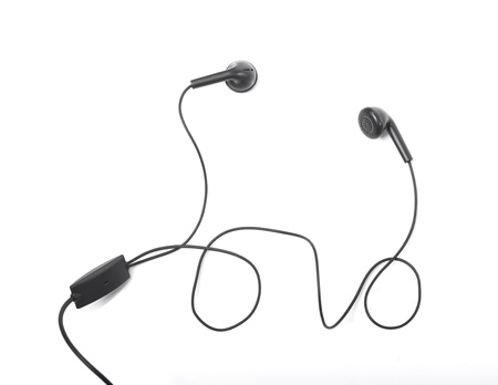Modern portable audio earphones isolated on a white background photo