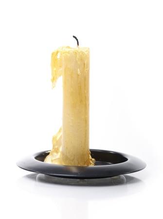 Burned candle isolated on white background
