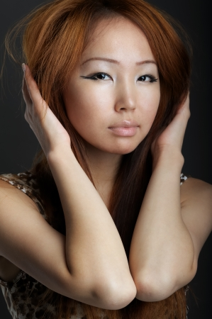 Asian woman on black background photo