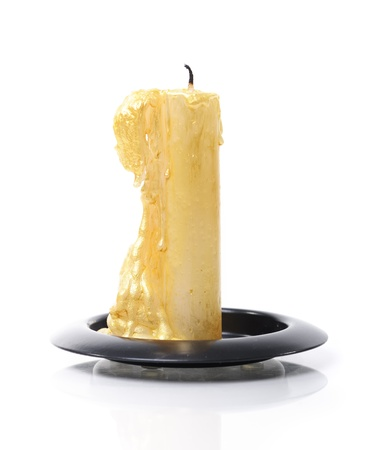 Burned candle isolated on white background photo