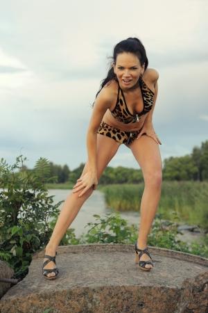 Woman in bikini on stones photo