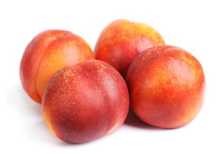 Nectarines isolated on a white background photo