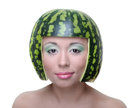 Funny woman with water-melon as helmet on head isolated Stock Photo - 15043207