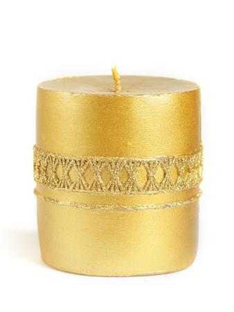 velas de navidad: Vela de oro aisladas sobre fondo blanco