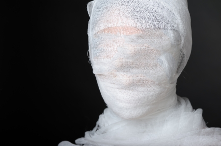 Portrait with bandaged face photo