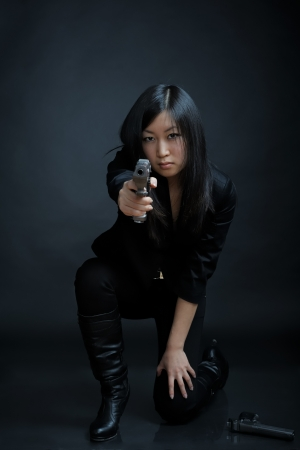 Asian woman with a pistol photo