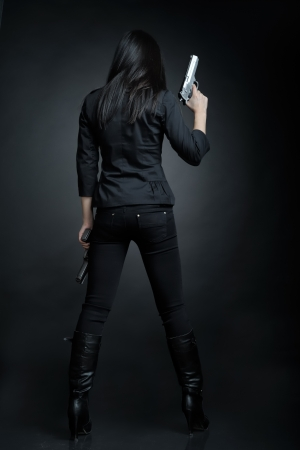 weapons: Asian woman with a pistol Stock Photo