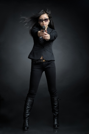 Asian woman with a pistol Stock Photo