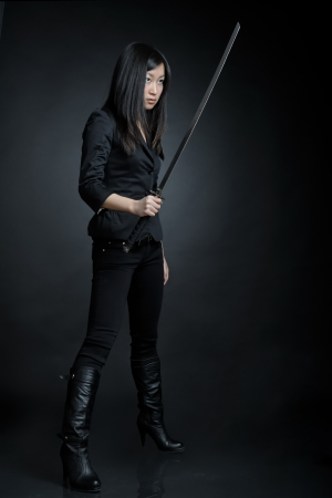Asian woman with a sword photo