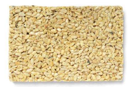 gozinaki: Honey bars with sunflower seeds isolated on white background