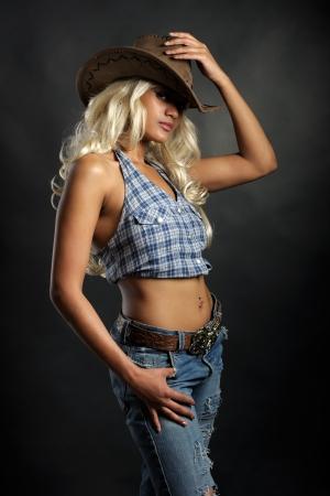 vaqueras: Joven dama en un sombrero de vaquero
