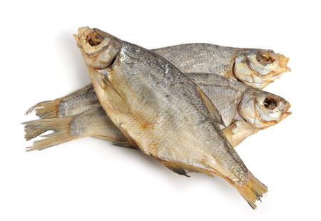 Dry fish isolated on white background photo