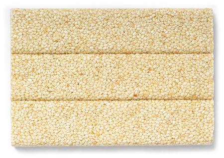 gozinaki: Honey bars with sesame seeds isolated on white