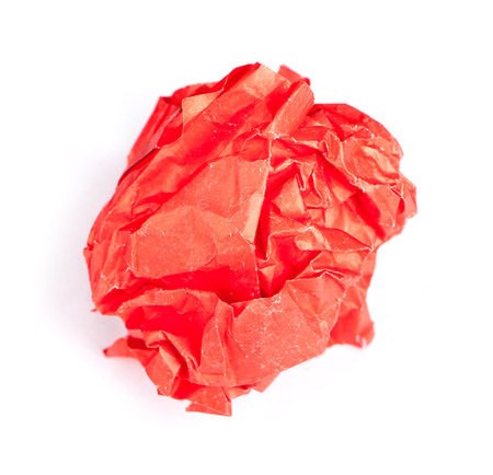 Screwed up piece of red paper isolated  Stock Photo
