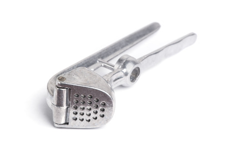 metal grater: Garlic masher isolated on white background