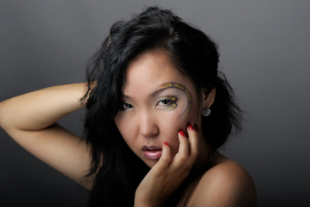 Portrait of asian woman with creative makeup photo