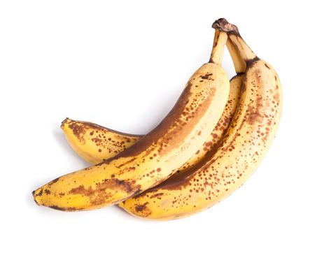 bad banana: Branch of overripe bananas isolated on white background Stock Photo
