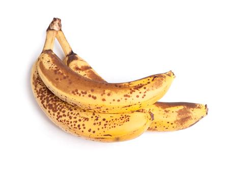 overripe: Branch of overripe bananas isolated on white background Stock Photo