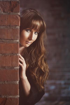 recline: Girl recline on the brick wall