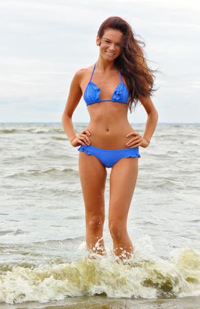 Woman in blue bikini at the sea photo