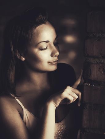 Woman touch brick wall photo