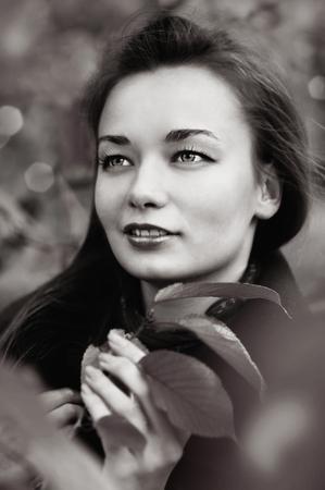 Portrait of beautiful woman outdoors photo