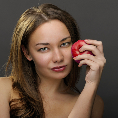 Woman with red apple photo
