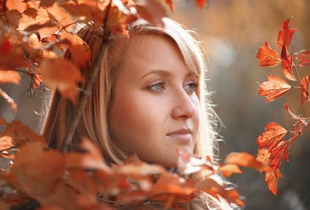 Portrait of woman at autumn photo