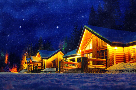 Snowy winter scene of a cabin in distance at night Banque d'images
