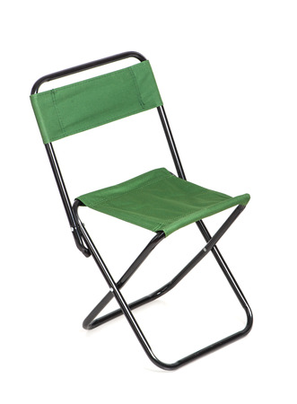collapsible: Folding chair with green fabric isolated on white background