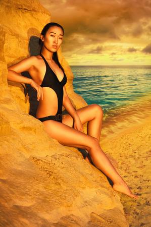 korean girl: Korean girl in bikini sitting on sand