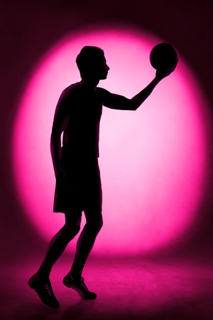 Silhouette del giocatore di basket photo