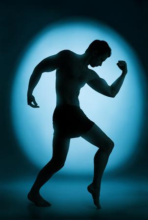 Silhouette del bodybuilder photo