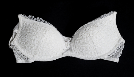 Beautiful white brassiere on black background