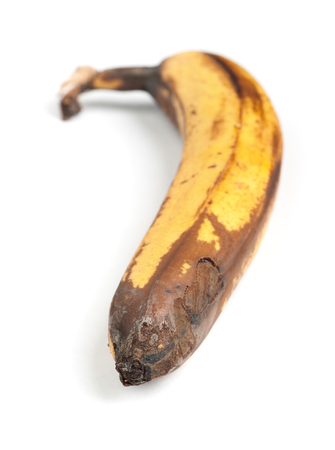 uneatable: Rotten banana isolated on white background