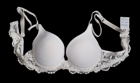 uplift: White brassiere on black background