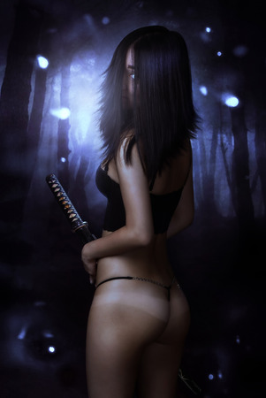 Sexy asian woman with katana sword at darkness