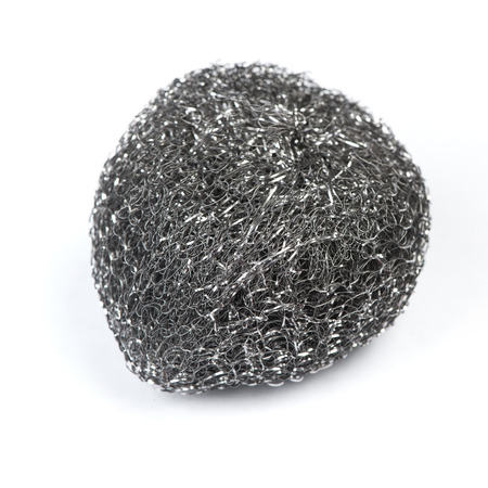 Metal sponge for washing dishes isolated on a white background