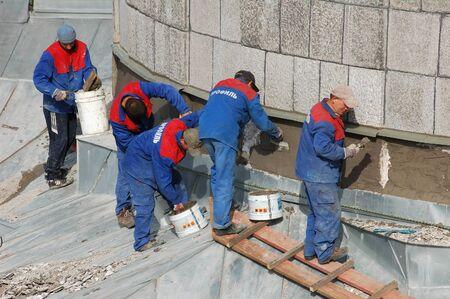 Crew of workers repairing historical building, Saint-Petersburg, Russian Federation - 12 September 2007
