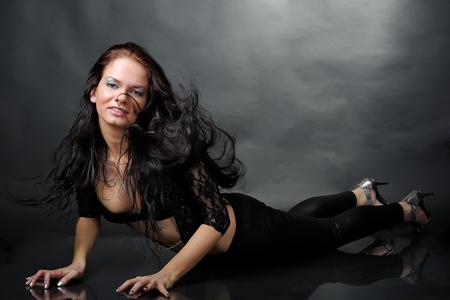 Woman in black dancing costume at studio