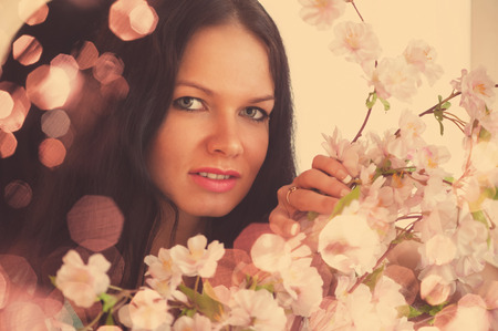 Floral portrait of young smiling woman