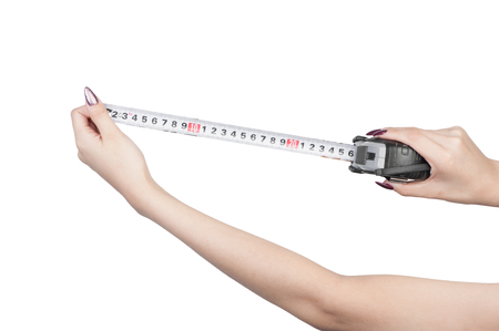 Measuring yardstick is female hands isolated on white background