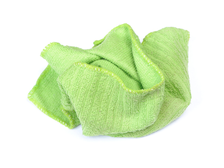 Crumpled green rag isolated on white background